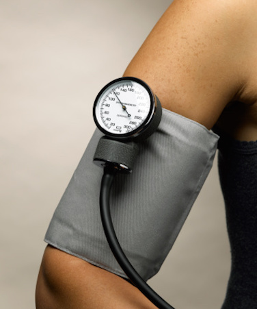 Arm with blood pressure reader wrapped around it