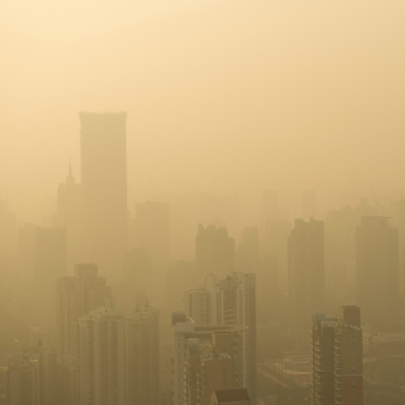 city shrouded in fog of air pollution