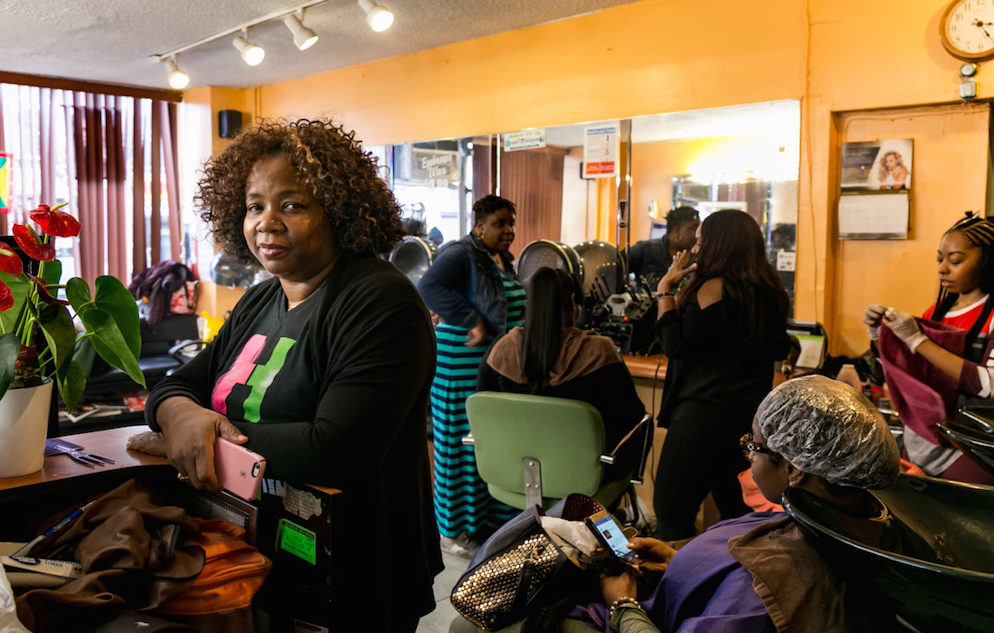Hermione Fraser, owner and stylist of Hermie's Salon in East Flatbush. A community-health program encouraged Fraser to nudge clients to get mammograms. One did and detected cancer in time for treatment. (Photo by Adi Talwar)