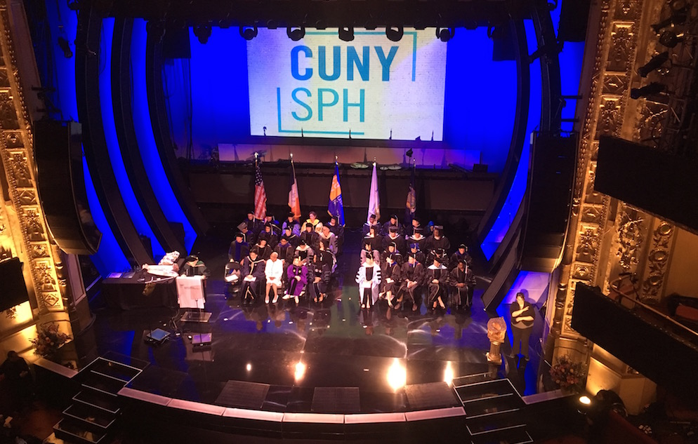 Overhead image of the faculty on the stage of the World Famous Apollo Theater during the CUNY SPH 2017 Commencement.