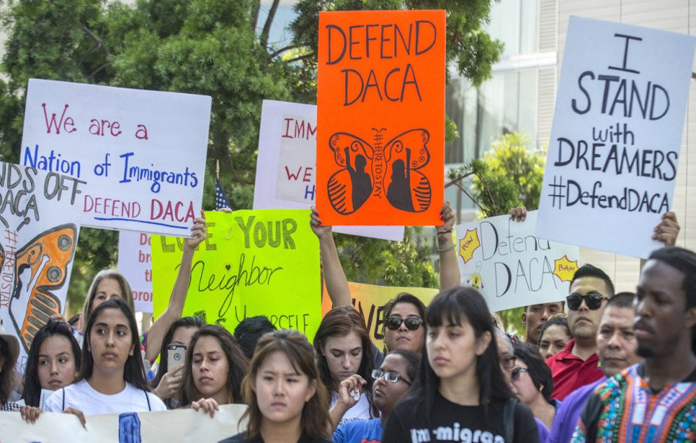 September 5, 2017 - Irvine, California, USA - Over 100 supporters of the Deferred Action for Childhood Arrivals program, DACA, carry signs in protest of the Trump administration formally announcing the end of DACA, outside the office of Congresswoman Mimi Walters, near the intersection of Michelson Drive and Jamboree Road in Irvine, on Tuesday, September 5, 2017. (Credit Image: © Mark Rightmire/The Orange County Register via ZUMA Wire)