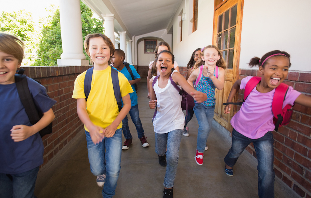 Students running down the hall at the elementary school