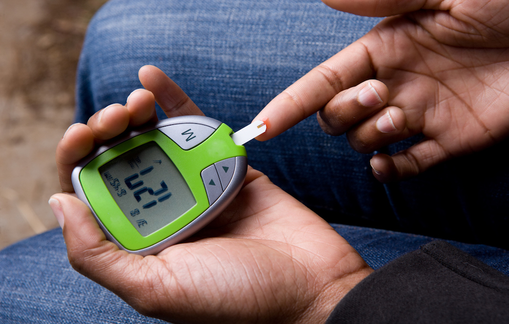 African American Woman Tests Blood Sugar