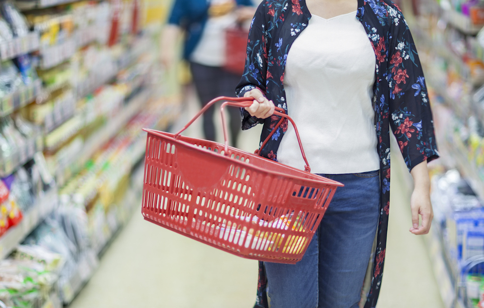 Person grocery shopping with basket