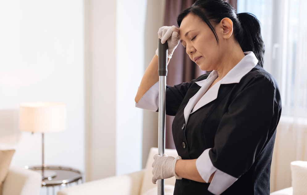 tired hotel housekeeping worker
