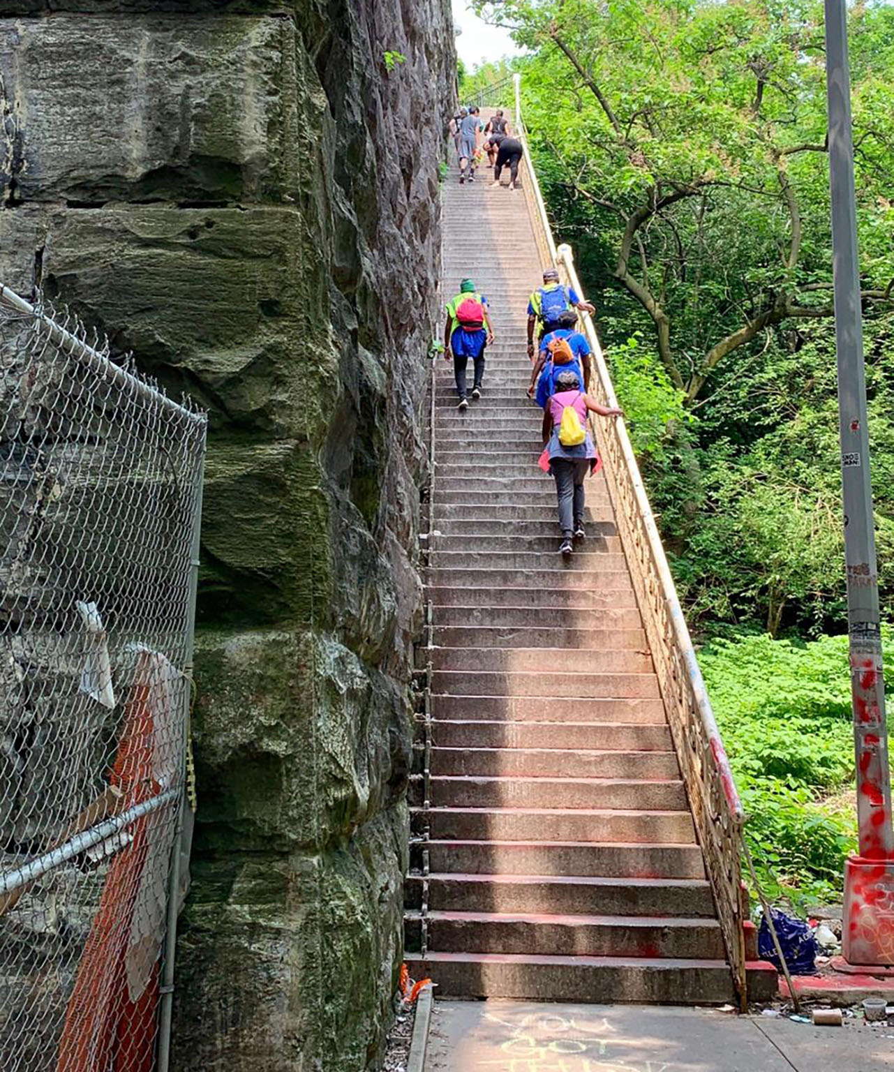 Hikers climbing stairs in NYC park