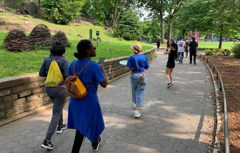 Hikers admiring art in Marcus Garvey park