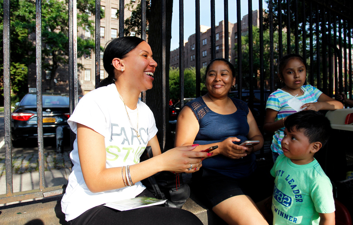 Former PARCS Study Project Manager Geranyi Rodriguez speaks with residents of the Bronx.