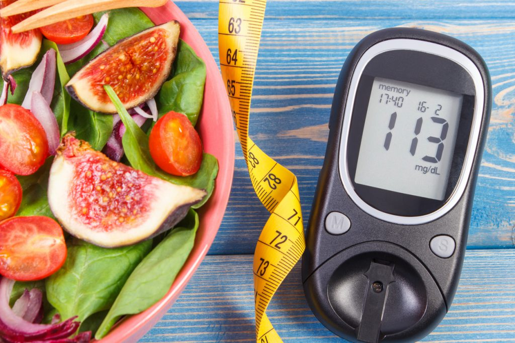Fruit and vegetable salad and glucose meter with tape measure