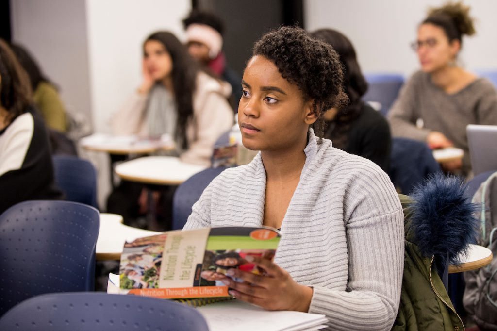 CUNY SPH student listening in class