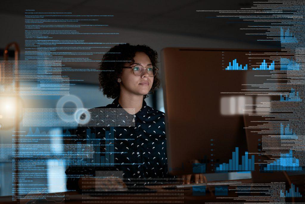 woman analyzing data code on computer screen