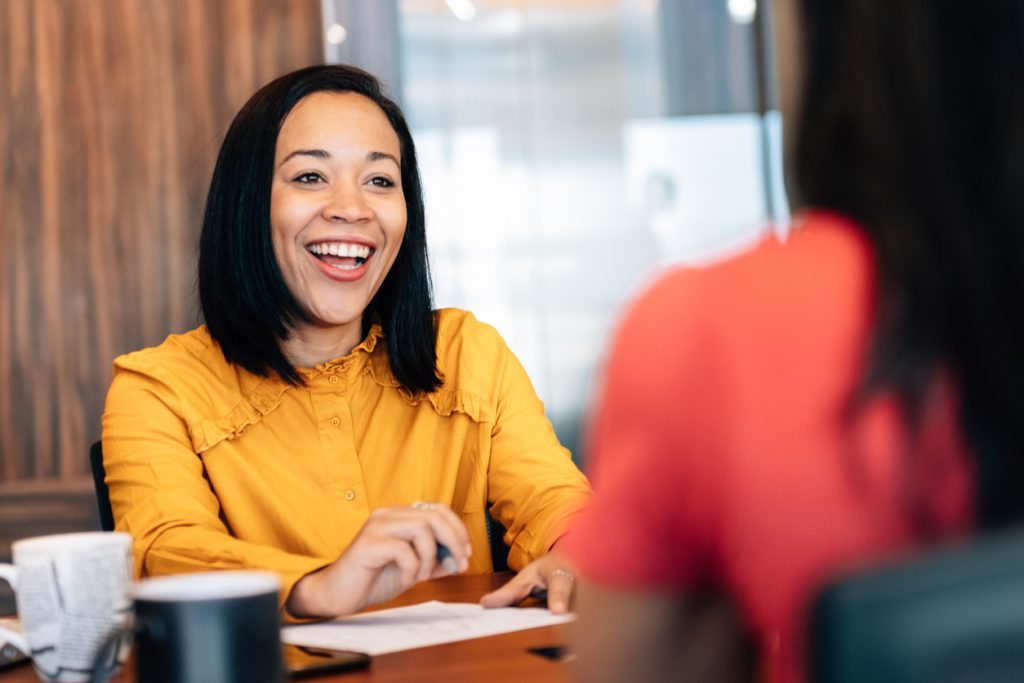 Financial Advisor smiling and talking with client