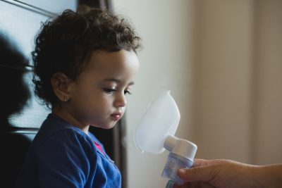 Little girl is offered nebulizer