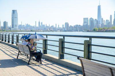 Mature man and woman looking at Manhattan