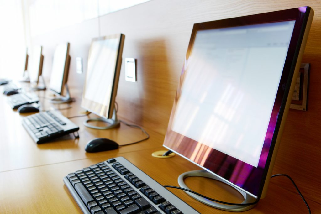 Row of computers in a classroom