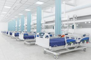 Empty beds in a hospital ward