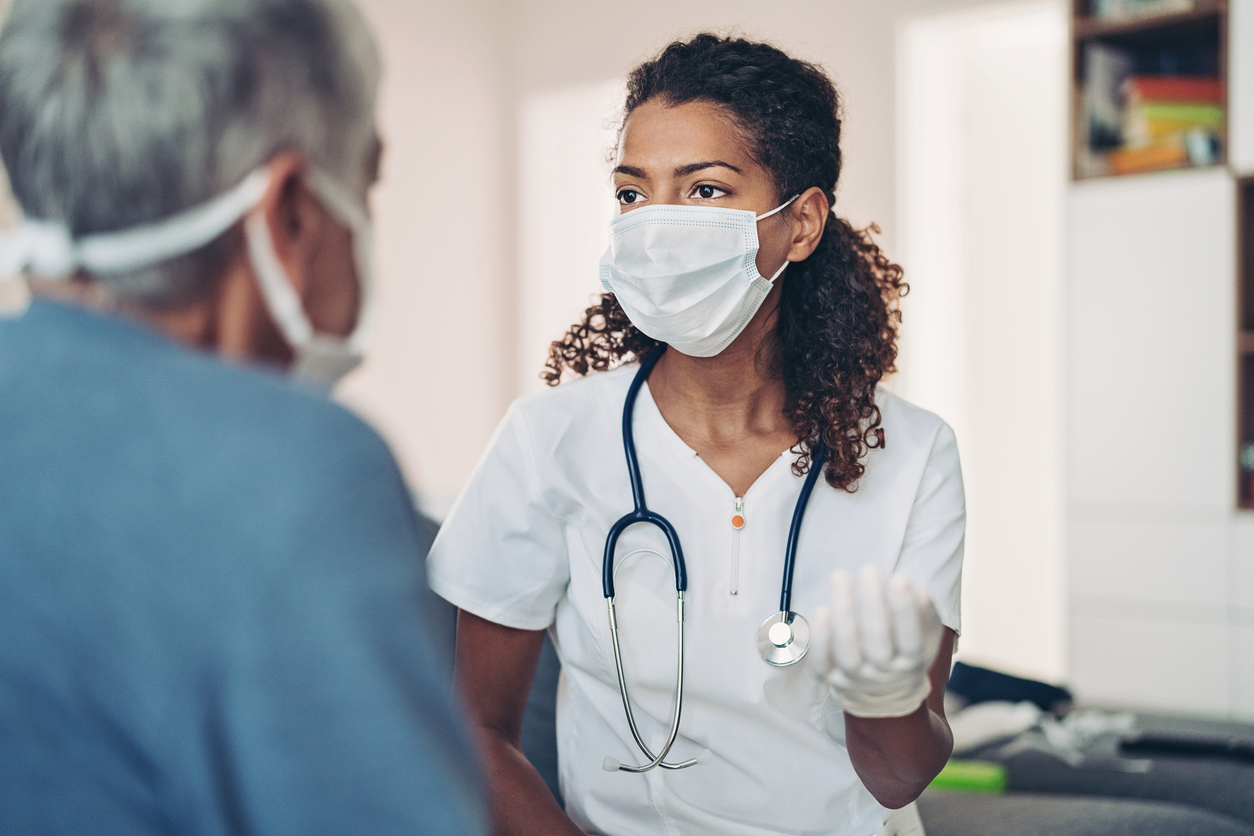 Female doctor talking with a senior patient