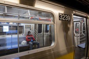 Subway commuter wearing respirator mask in New York City