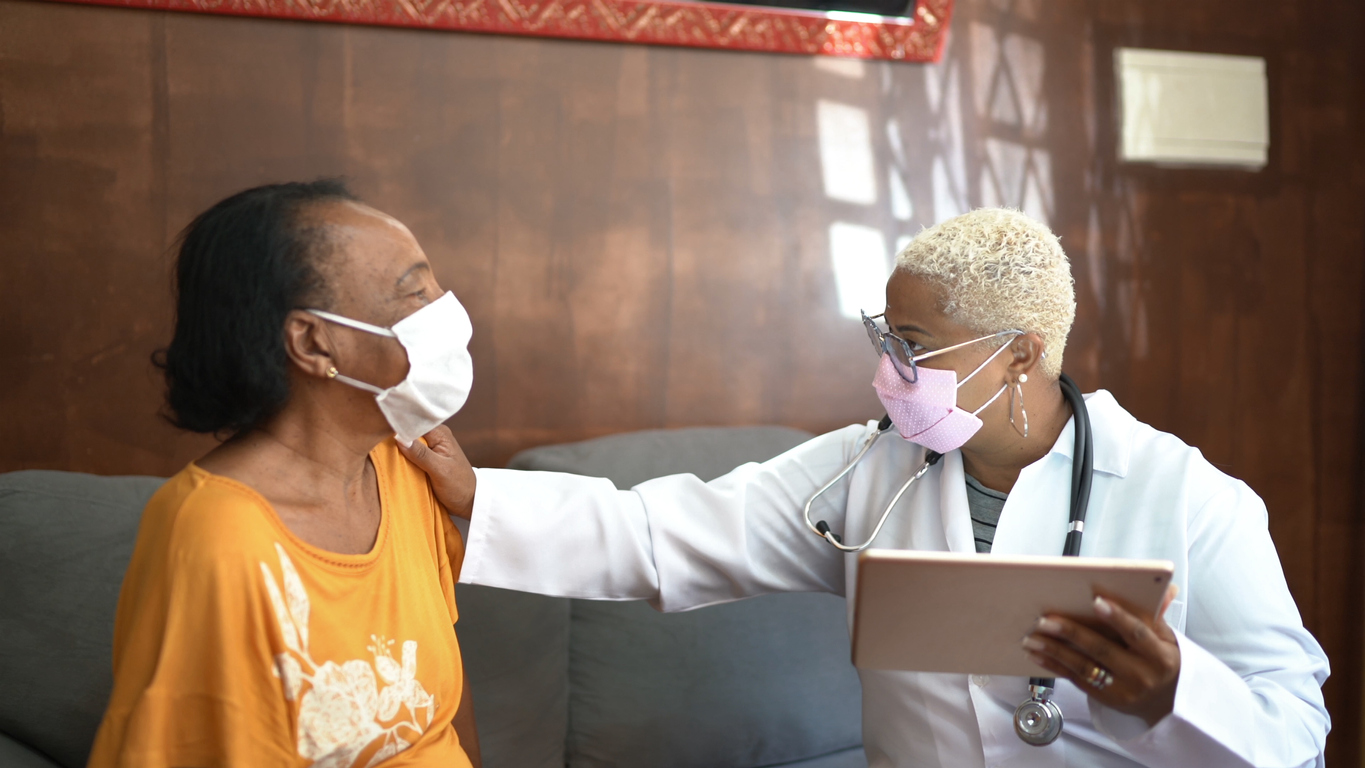 Doctor talking to senior female patient