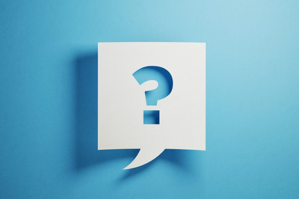 White chat bubble with question mark on blue background