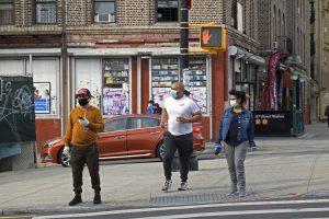 people crossing street wearing masks